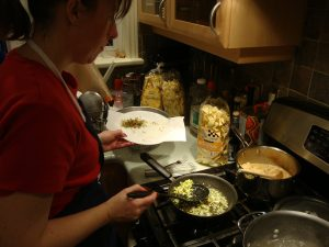 Tammy Cooking Pasta and Rabbit.