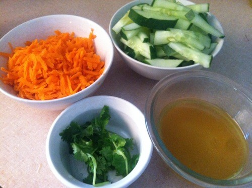 shredded carrots, sliced cucumbers, cilantro, dressing